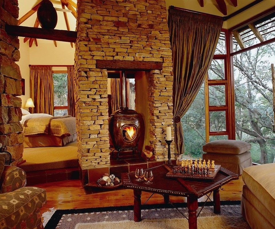 property chair living room house home Fireplace cottage mansion hearth farmhouse Villa log cabin stone