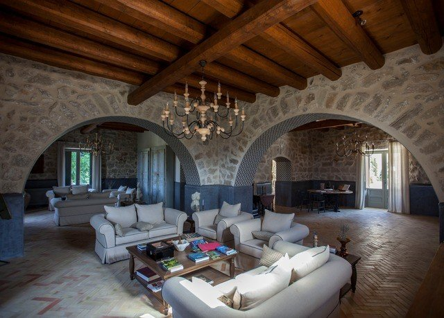 sofa Fireplace property living room Villa cottage home mansion farmhouse stone hacienda loft