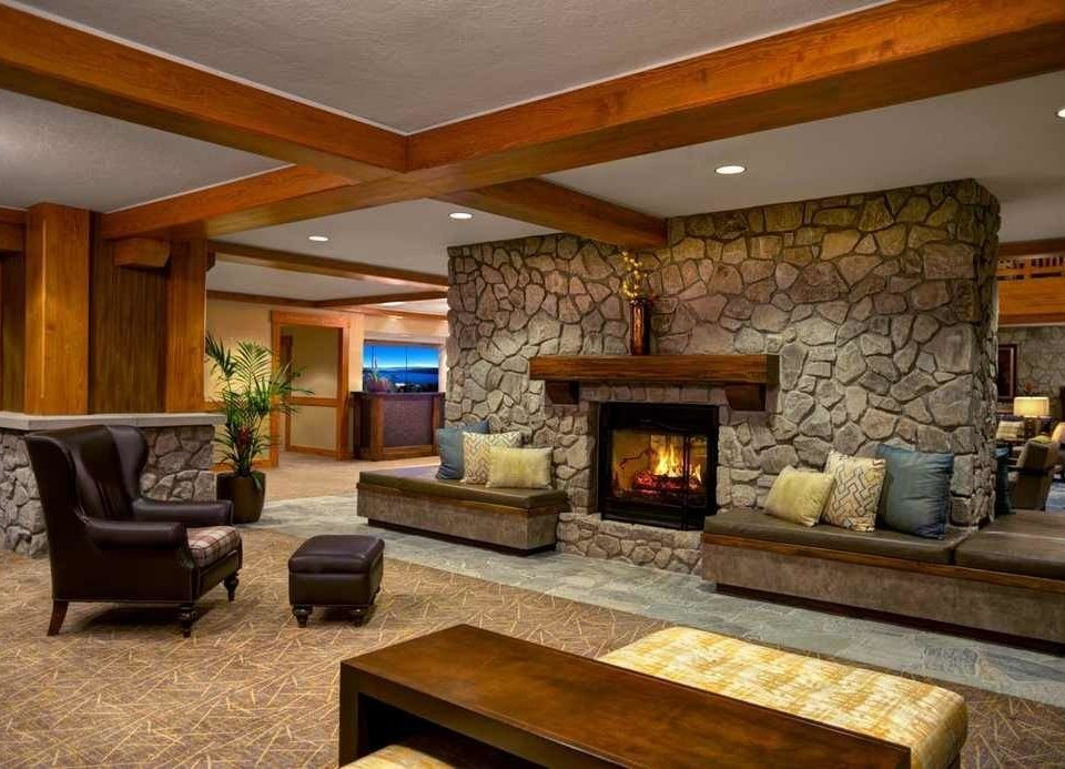 sofa living room Fireplace property home hearth hardwood cottage recreation room log cabin farmhouse Villa mansion stone