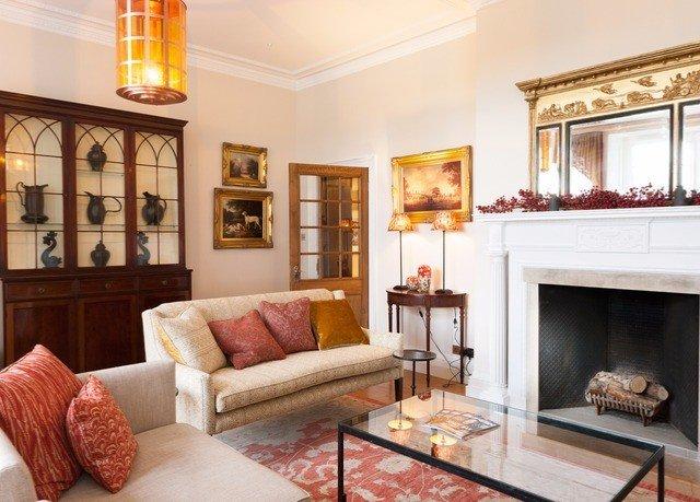 sofa living room property Fireplace fire home hardwood hearth cottage Villa mansion flat