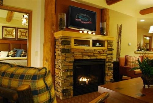 Fireplace sofa fire property living room television home cottage hardwood Villa mansion hearth flat