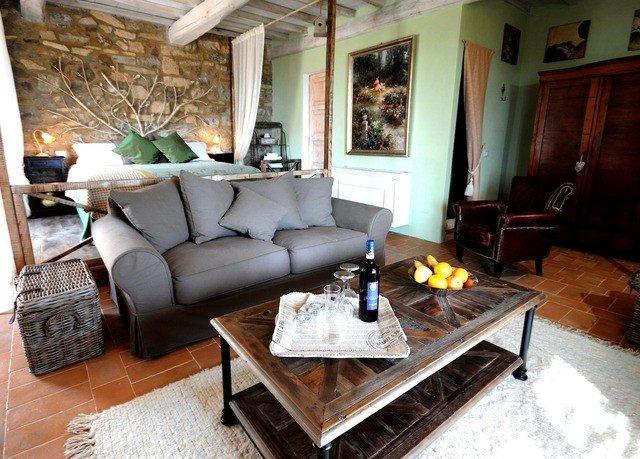 sofa living room property Fireplace home hardwood cottage Villa leather stone