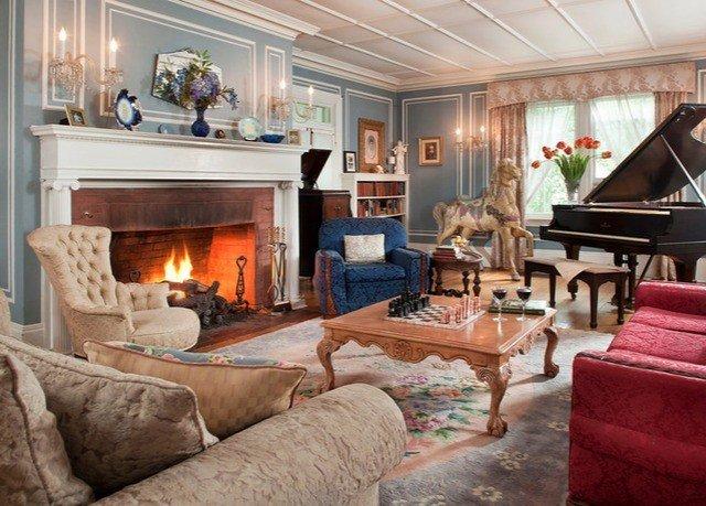 sofa Fireplace living room property home cottage mansion Villa
