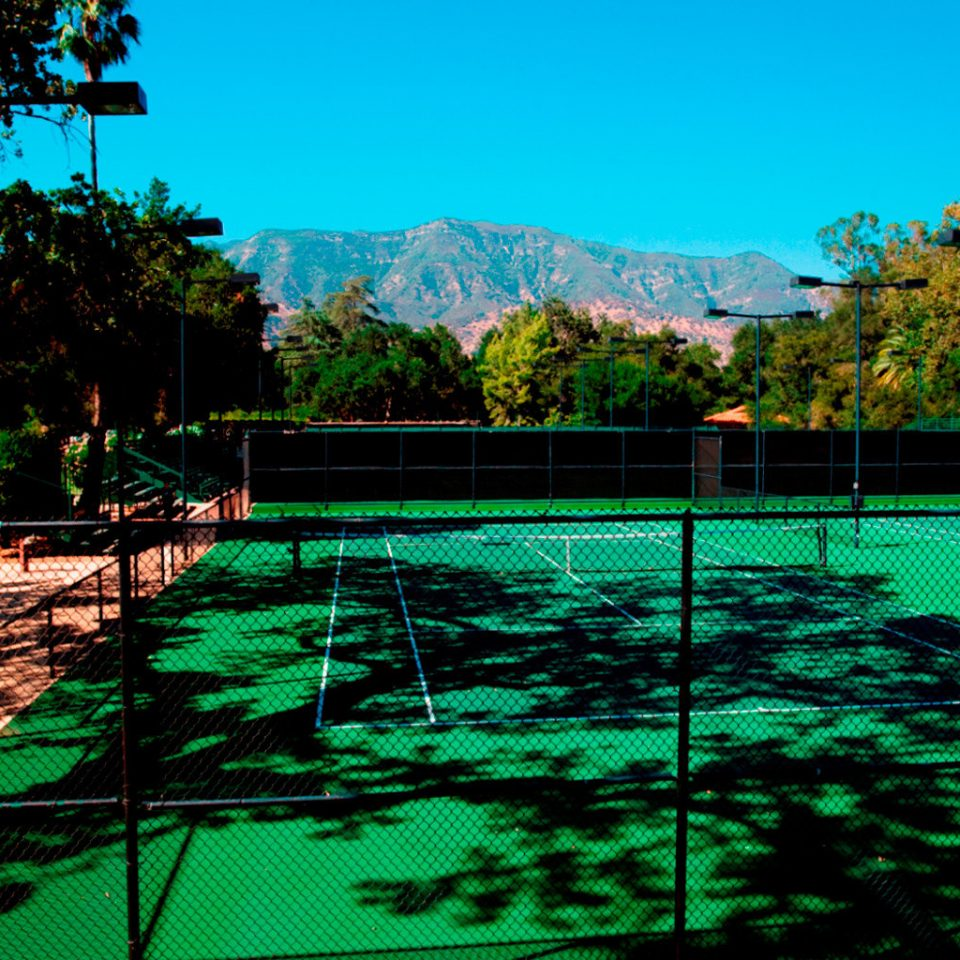 Fitness Mountains Nature Outdoor Activities Outdoors Scenic views Sport tree swimming pool athletic game green grass tennis backyard Garden park surrounded lush
