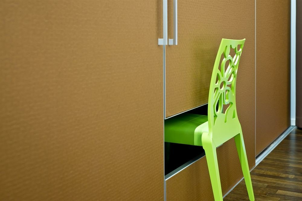 green handrail yellow hardwood product flooring glass shelf stairs molding