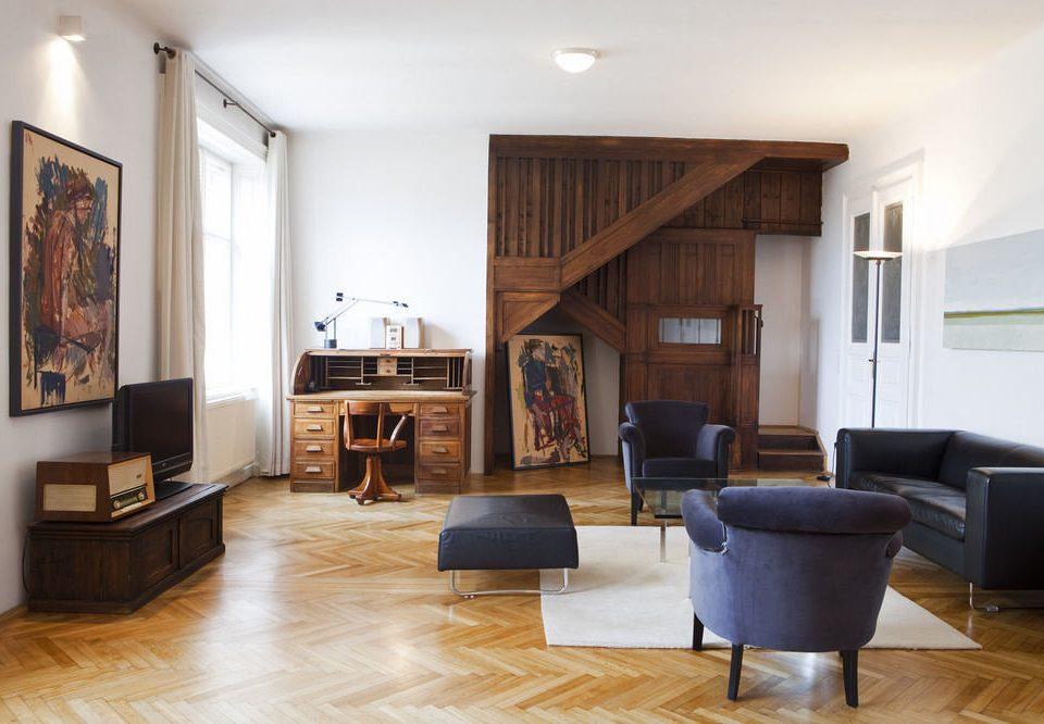 living room property home hardwood wood flooring flooring laminate flooring loft rug hard