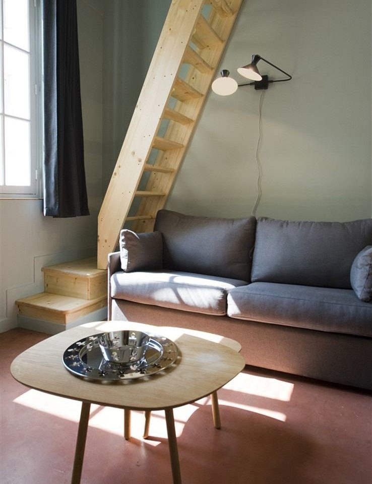 sofa living room hardwood lighting home flooring seat leather