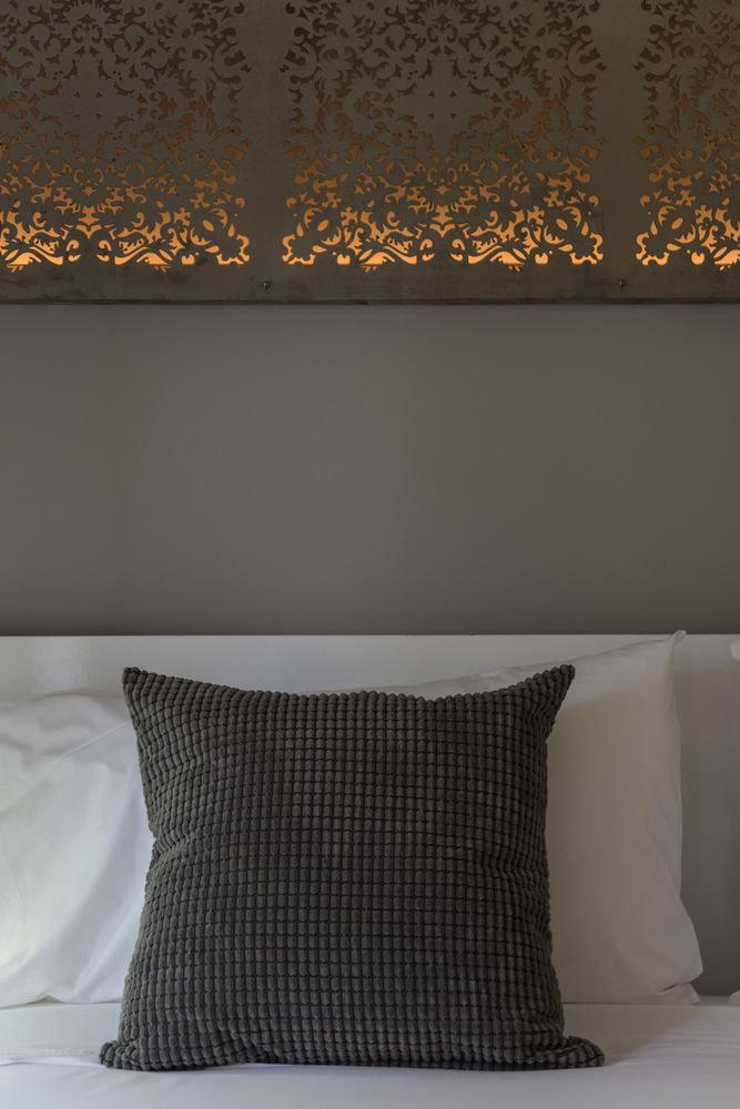 lighting living room pattern flooring wallpaper textile sofa night