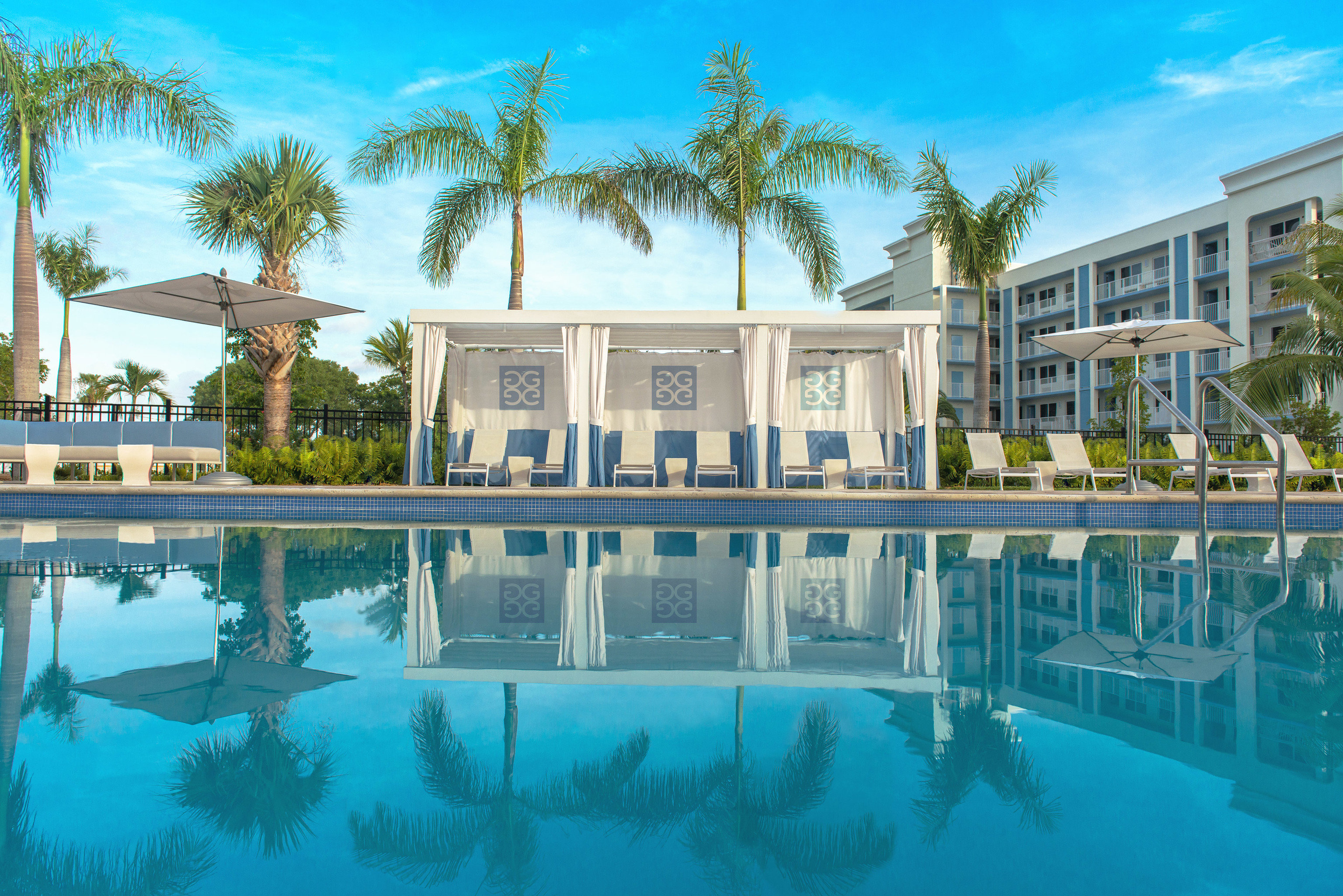Florida Hotels tree sky swimming pool building property Resort condominium leisure mansion home reflecting pool Villa resort town palace surrounded