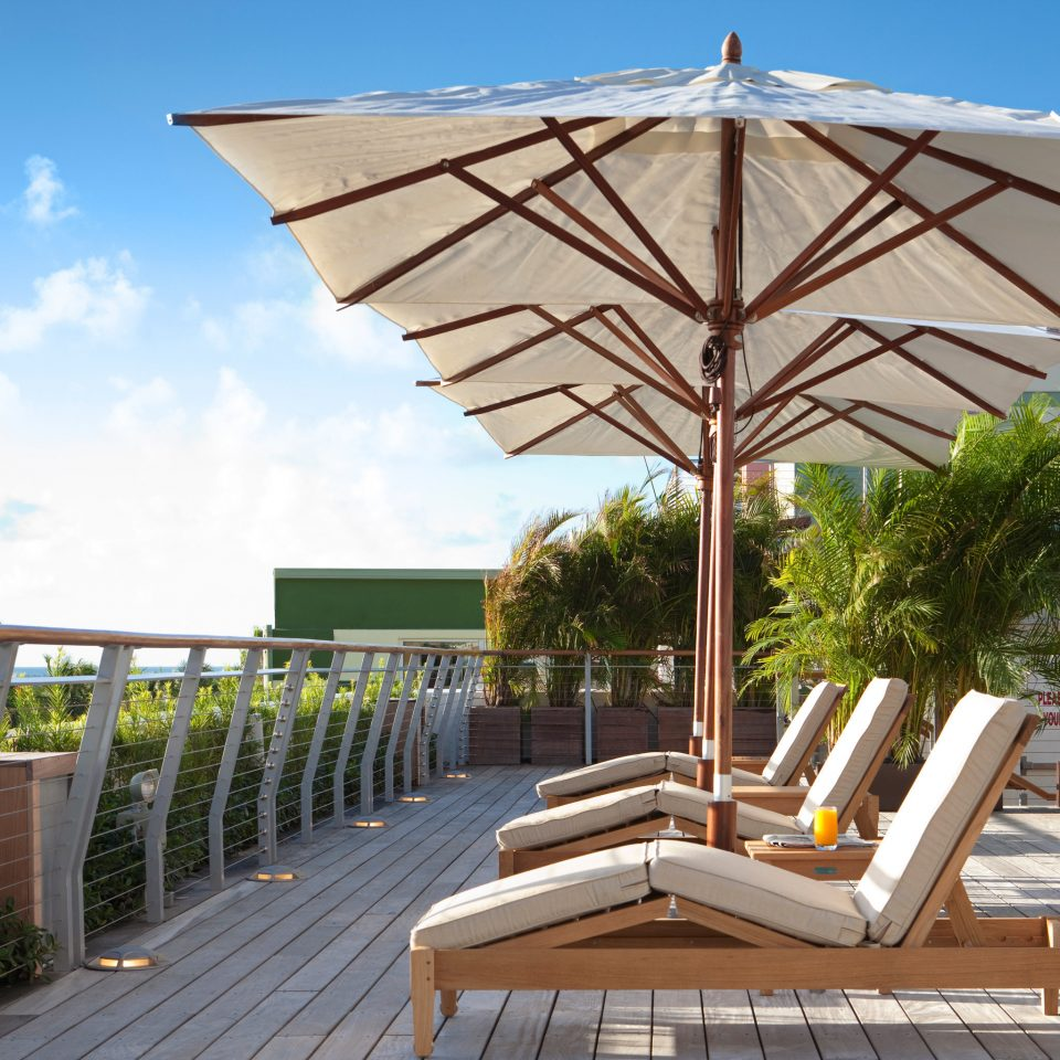 Food + Drink Girls Getaways Hotels Jetsetter Guides Lounge Patio Resort Rooftop Scenic views shopping Style + Design Weekend Getaways sky tree umbrella chair accessory walkway outdoor structure set shade day