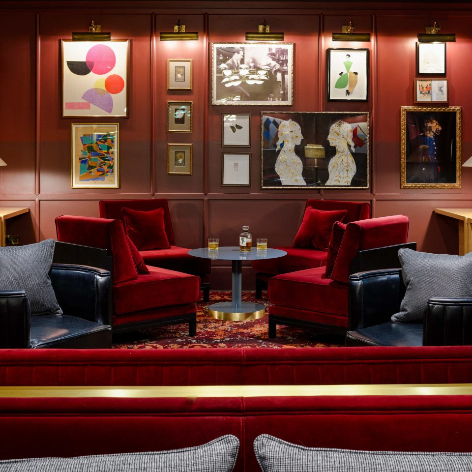 Food + Drink Trip Ideas red living room Lobby restaurant bright colorful colored