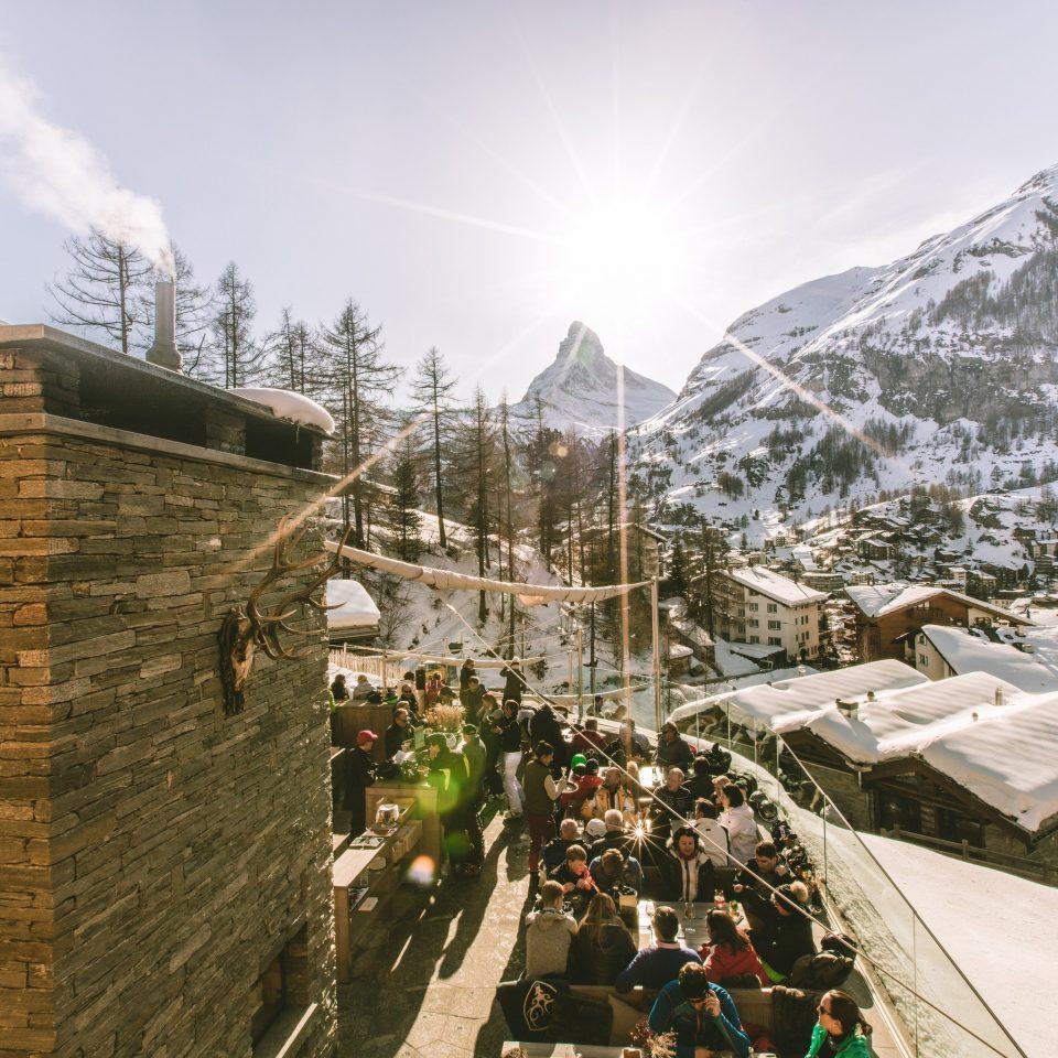 Food + Drink Mountains + Skiing sky snow geological phenomenon mountain range mountain Resort alps house