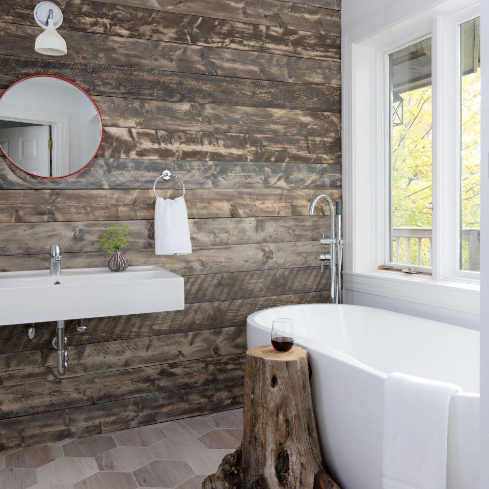 Food + Drink Outdoors + Adventure Trip Ideas Weekend Getaways Winter bathroom property home flooring tile plumbing fixture bathtub cottage living room stone