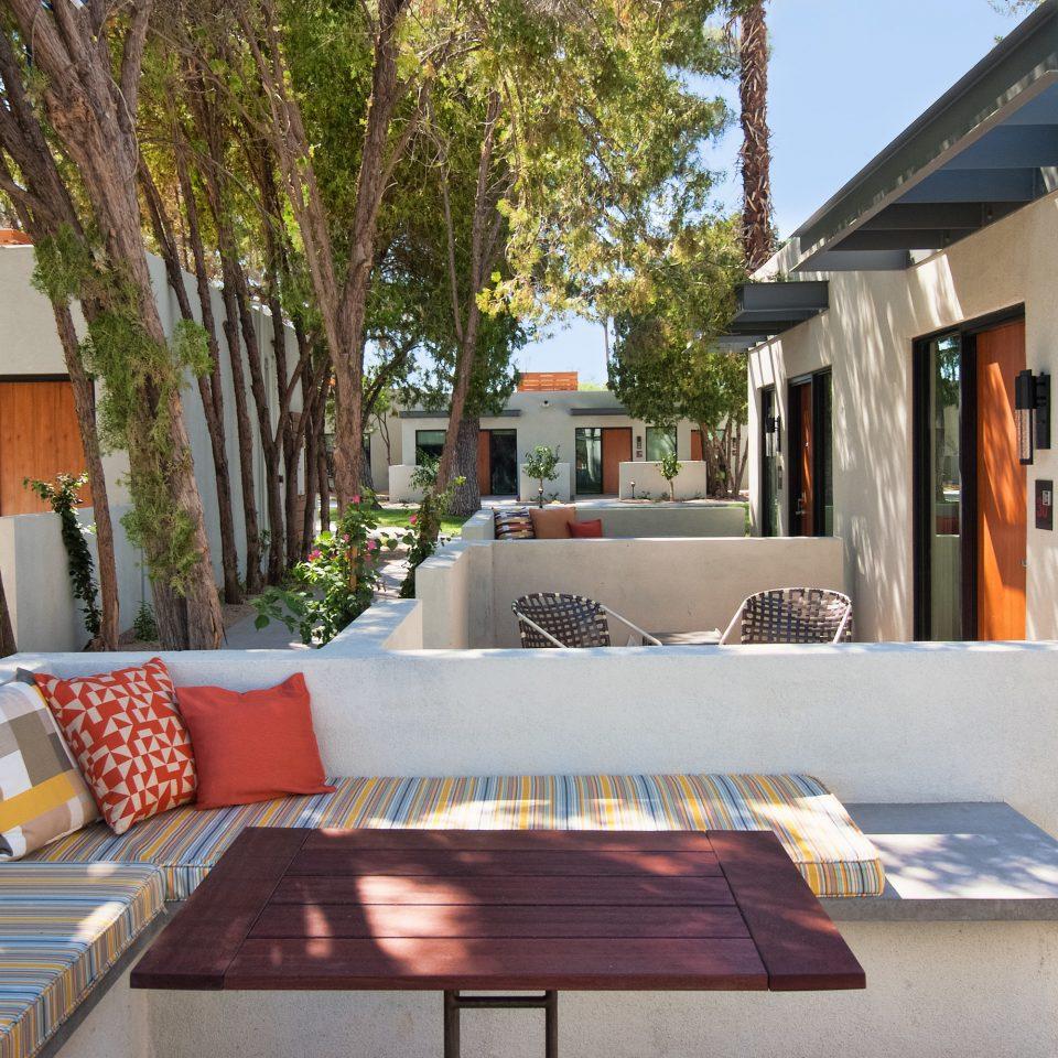 Food + Drink tree property house home condominium restaurant Villa Resort cottage outdoor structure backyard
