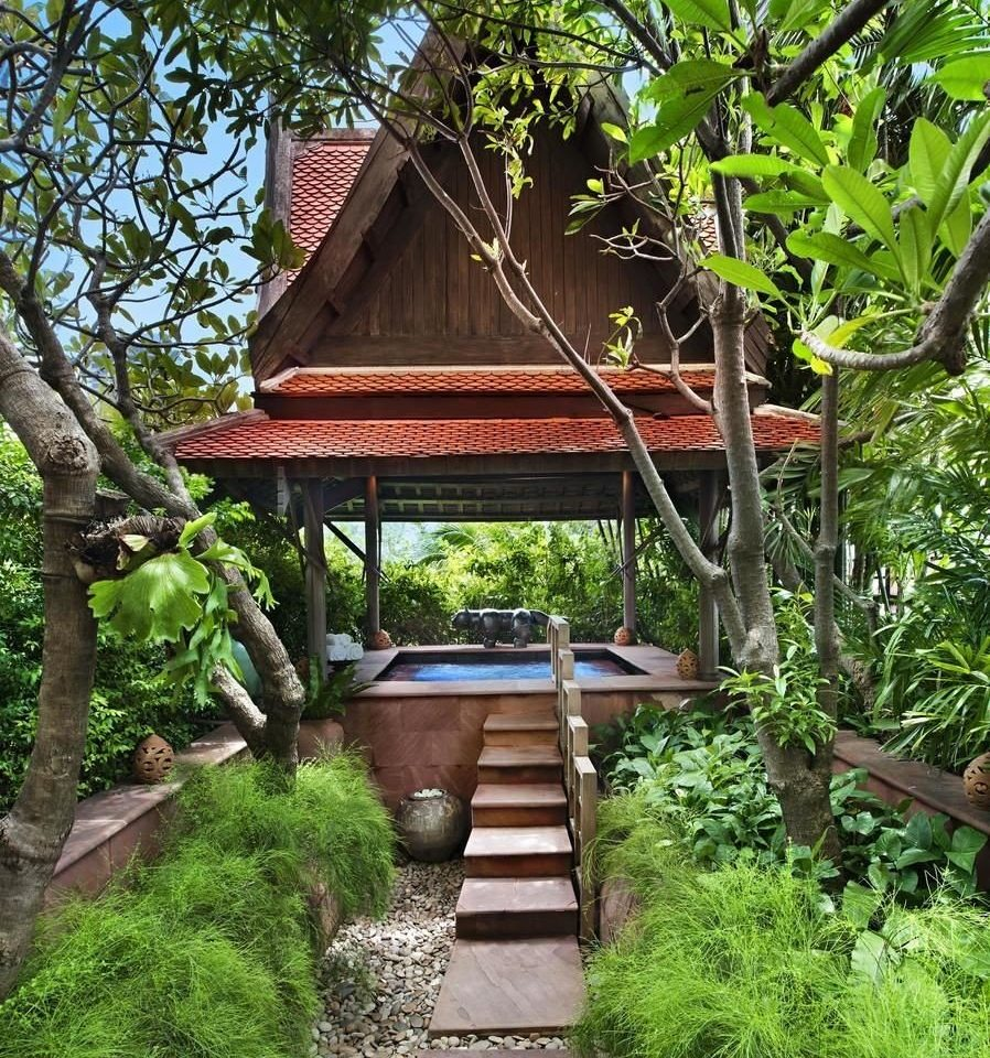tree house botany Garden Jungle Resort outdoor structure cottage shinto shrine shrine rainforest backyard temple hut flower botanical garden stone surrounded bushes lush Forest