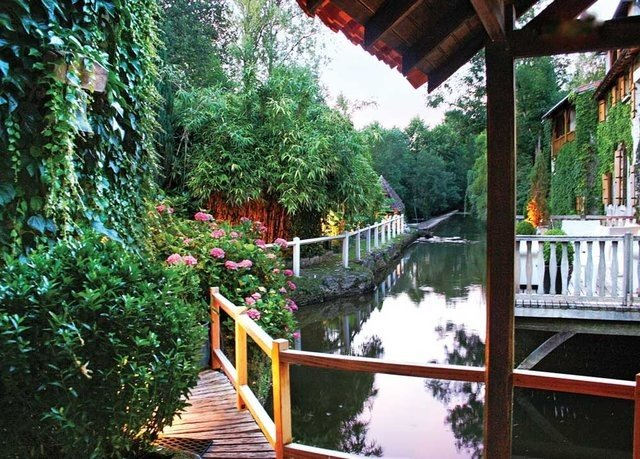 tree building porch flower Garden shrine walkway Resort waterway outdoor structure temple Forest wooded