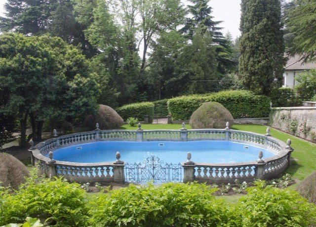 tree grass swimming pool property reflecting pool Villa Resort mansion Forest Garden wooded