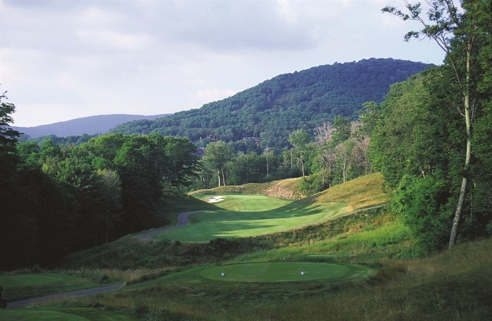 Golf Lodge Mountains tree grass highland sky mountainous landforms Nature mountain structure green lush hill field sport venue grassy mountain range rural area valley golf course reservoir meadow loch plateau Lake pasture hillside surrounded wooded Forest
