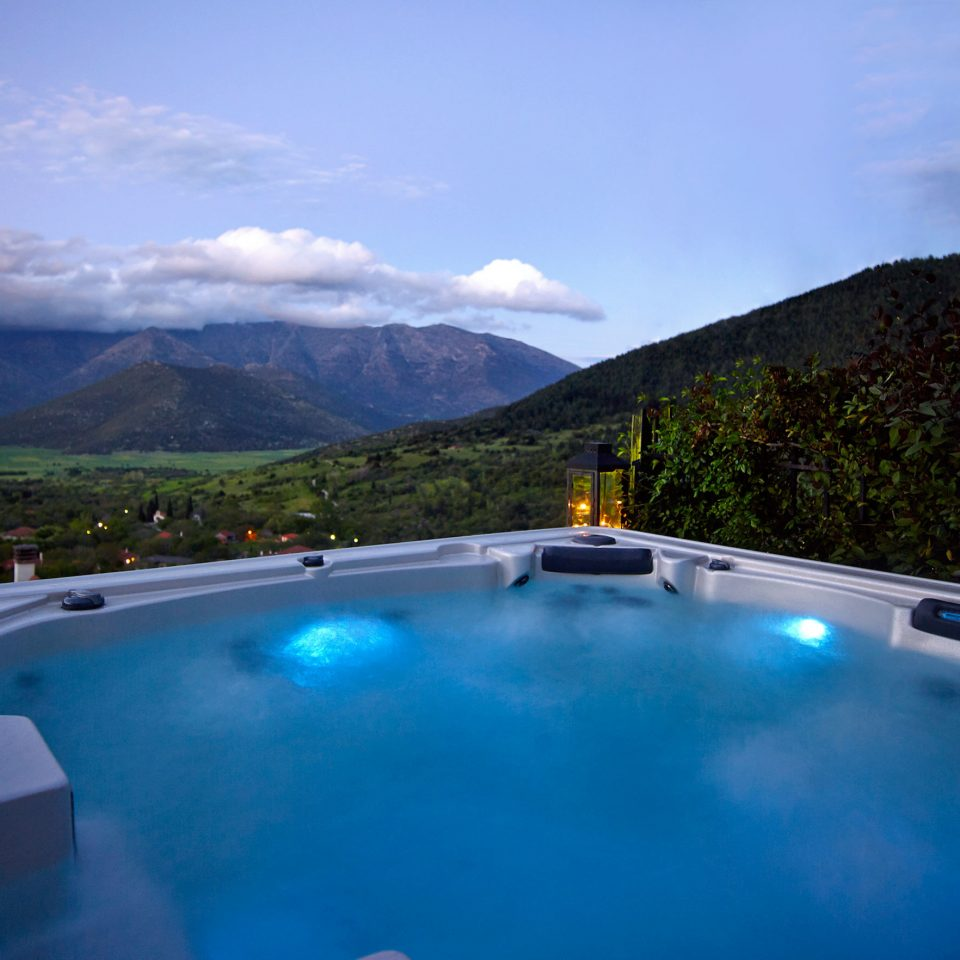 Forest Grounds Hot tub Hot tub/Jacuzzi Mountains Nature Outdoors Scenic views mountain sky swimming pool Villa highway