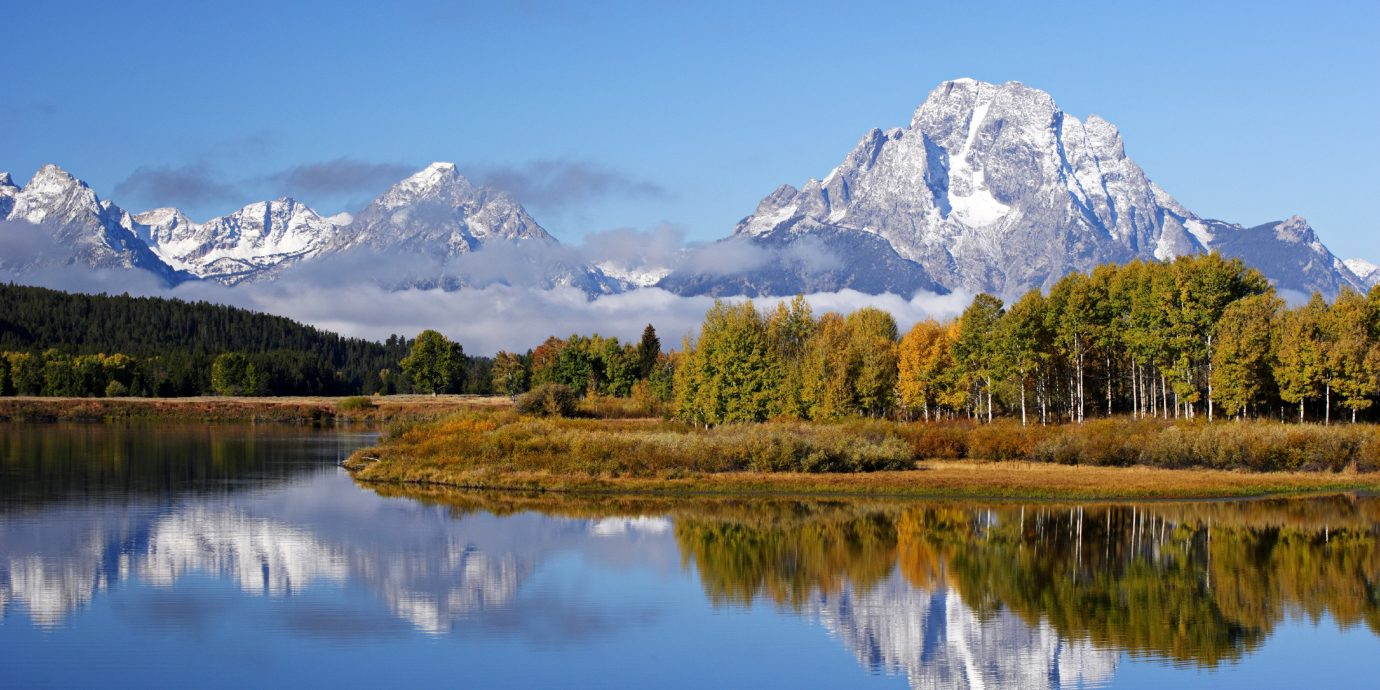 Mountains Natural wonders Nature Outdoor Activities Outdoors Ski Sport Waterfront water mountain Lake sky mountainous landforms wilderness mountain range atmospheric phenomenon tree River season loch landscape surrounded alps meadow autumn plateau national park reservoir Forest pond distance