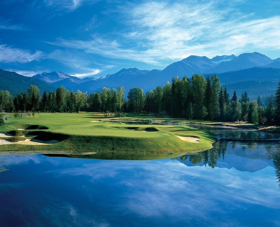 water tree sky mountain Nature structure River Lake sport venue grassland golf course golf club mountain range surrounded Forest meadow reef wooded