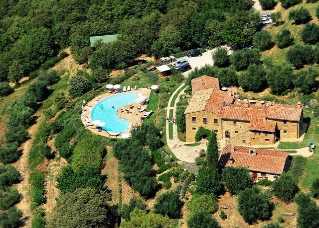 tree mountain bird's eye view aerial photography mansion Nature Village castle monastery hillside lush Forest surrounded