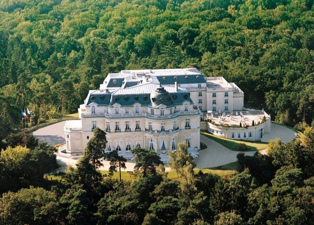 tree landmark Forest Resort palace white mansion background aerial photography bird's eye view surrounded wooded hillside