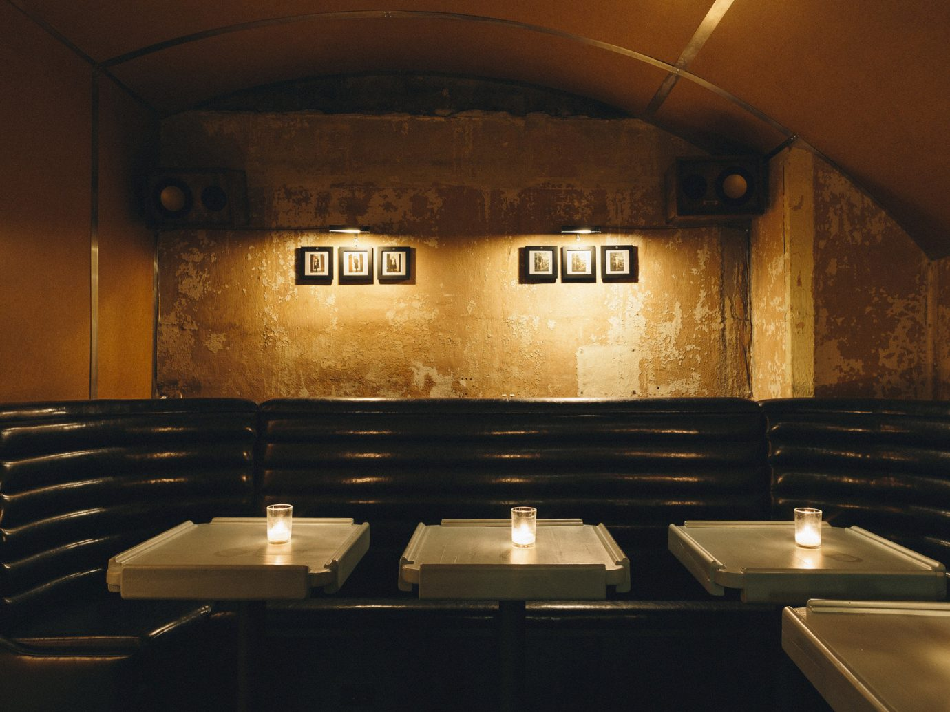 ambient lighting Bar charming cozy dark dim Food + Drink Hip industrial interior moody quaint Rustic Style + Design tables trendy Trip Ideas Weekend Getaways indoor wall man made object ceiling room restaurant lighting auditorium interior design counter
