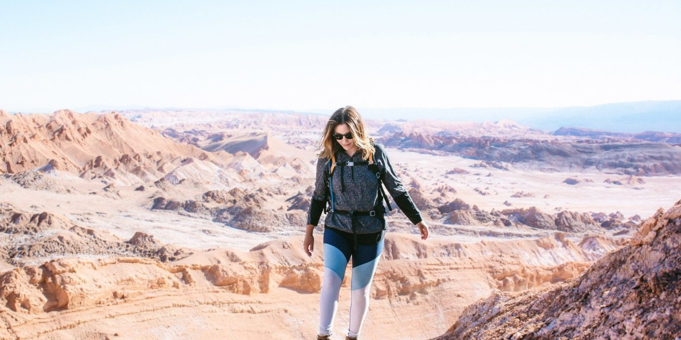 Influencers + Tastemakers Travel Shop Trip Ideas mountainous landforms badlands sky wilderness mountain ridge girl rock vacation wadi hill terrain landscape canyon tourism geology fell travel aeolian landform mountain range sand Desert escarpment summit plateau walking elevation fun makhtesh Adventure formation