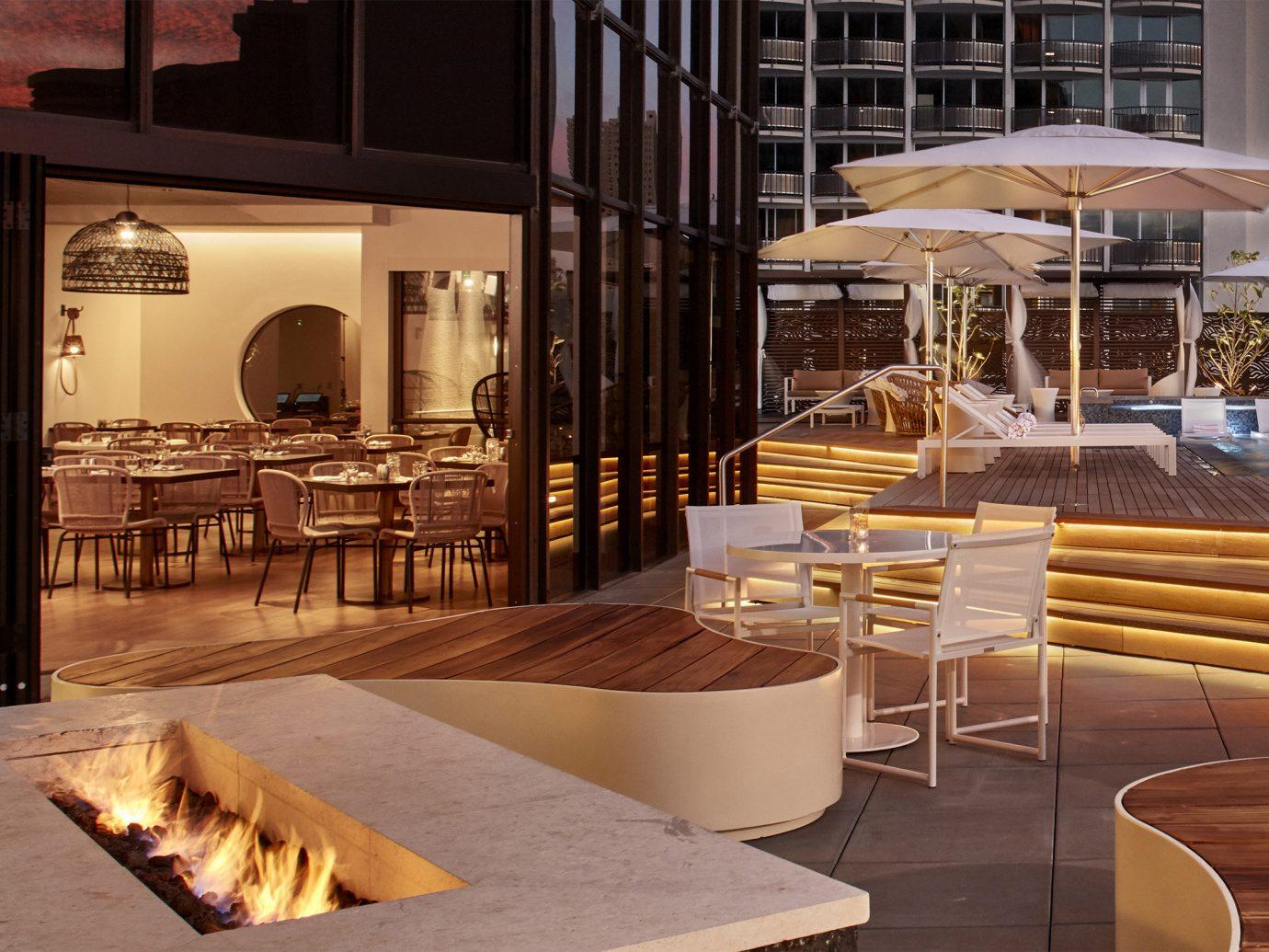 Boutique Hotels interior design wood furniture Lobby restaurant table estate