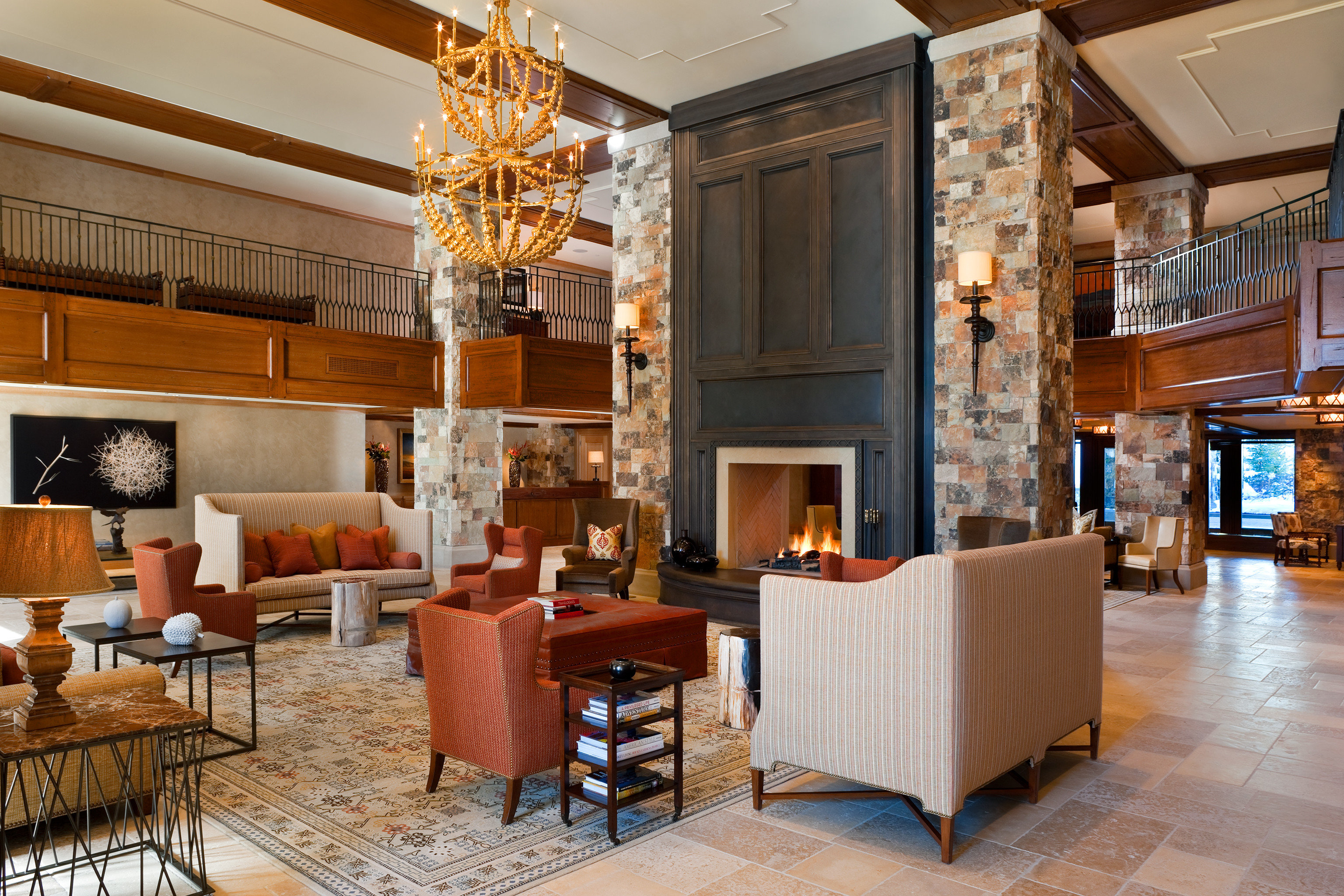 Firepit Fireplace Hip Living Lounge Luxury Modern Trip Ideas floor indoor room chair property living room dining room window estate home ceiling Lobby hardwood interior design cabinetry real estate wood Design condominium furniture wood flooring Kitchen mansion area
