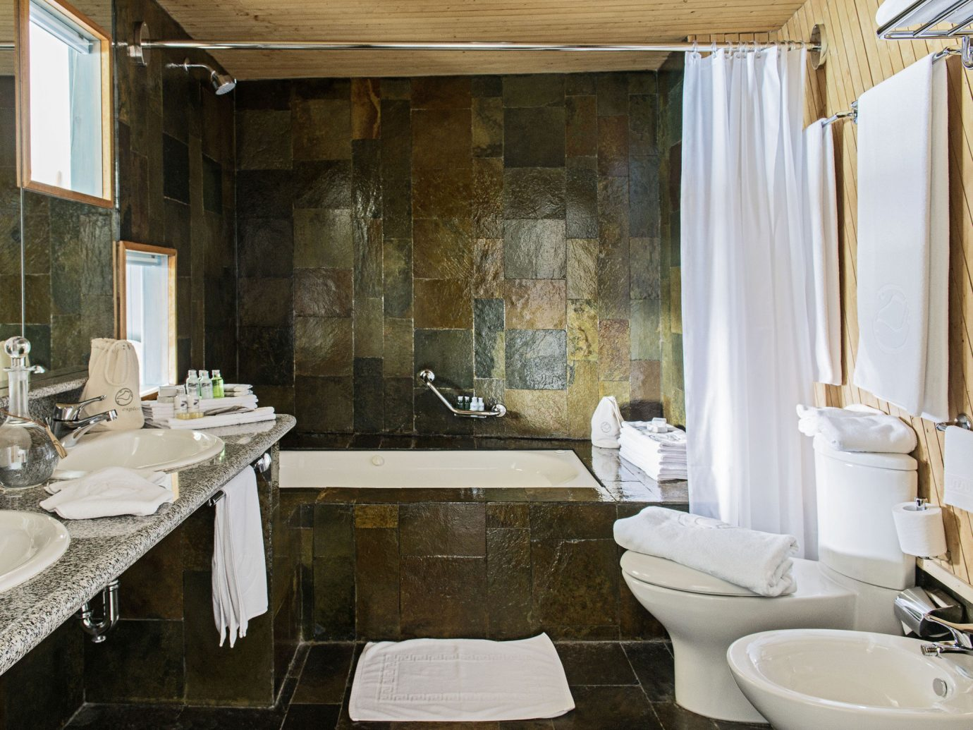 All-Inclusive Resorts Hotels Luxury Travel indoor bathroom sink room window property estate interior design home floor Suite counter Design toilet tub bathtub Bath tiled
