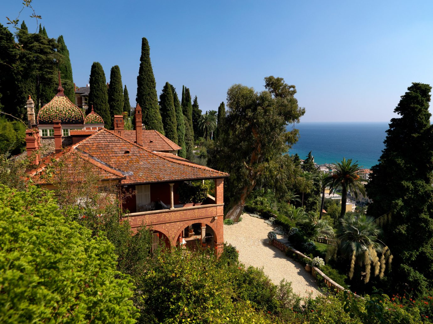 Italy Trip Ideas sky vegetation property tree plant estate house cottage mountain village real estate mountain home Villa Village terrain mount scenery roof landscape hill mansion tourism hacienda arecales
