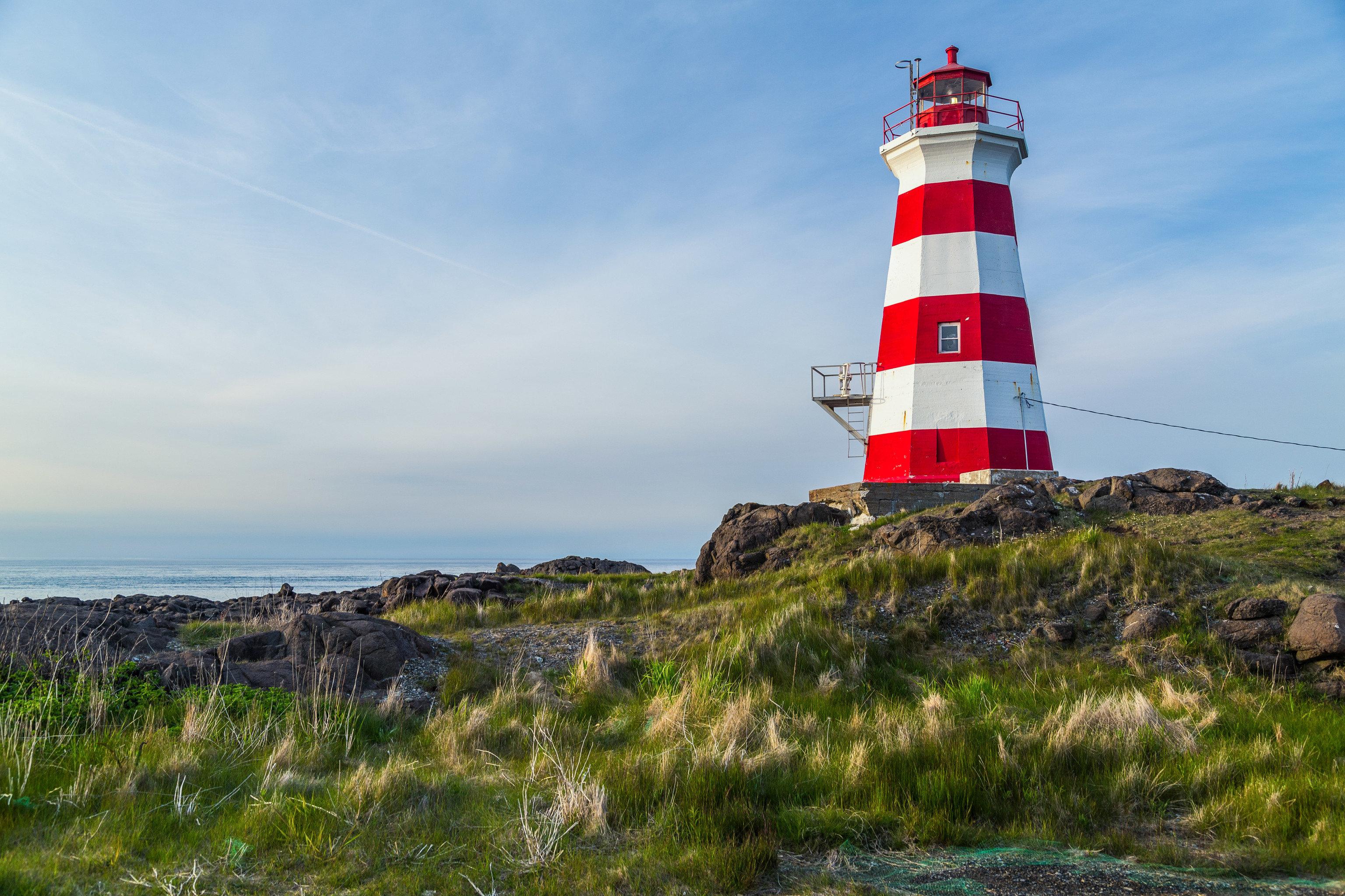 Trip Ideas grass sky outdoor lighthouse tower Coast Sea hill Ocean green grassy cape cove hillside lush
