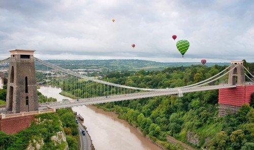Trip Ideas sky tree outdoor transport bridge green vehicle lush hillside