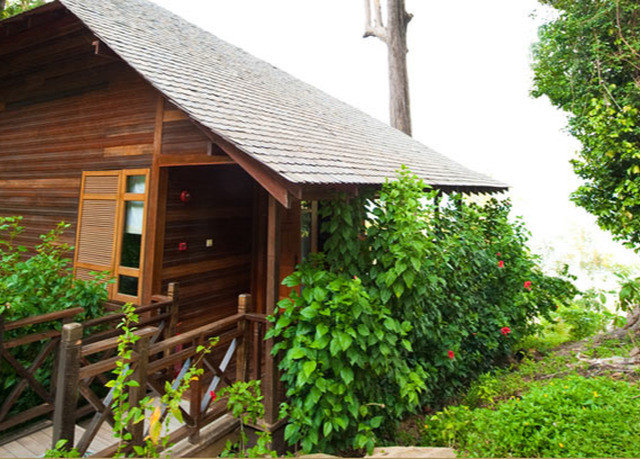 tree property building house Garden cottage outdoor structure backyard home wooden plant shed yard bushes