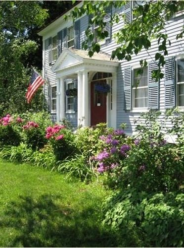 tree grass building property home flower house yard lawn cottage Garden backyard porch siding outdoor structure landscaping shrub plant bushes