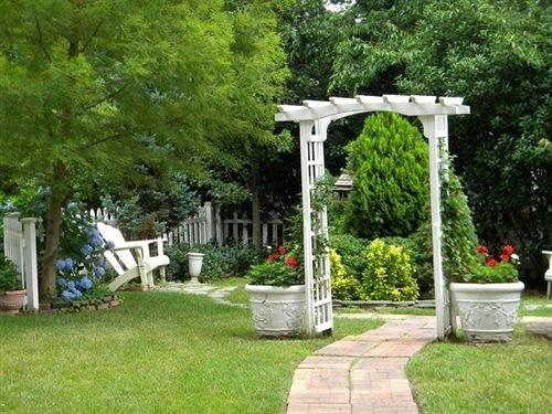 tree grass cemetery yard park backyard lawn outdoor structure Garden