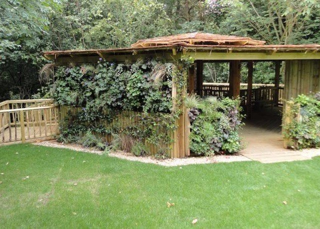 grass tree property backyard outdoor structure yard house green shed lawn cottage pergola Garden lush