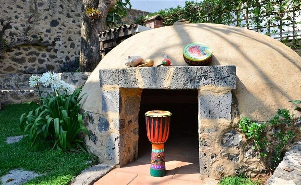 rock man made object backyard stone yard Garden masonry oven outdoor structure cottage