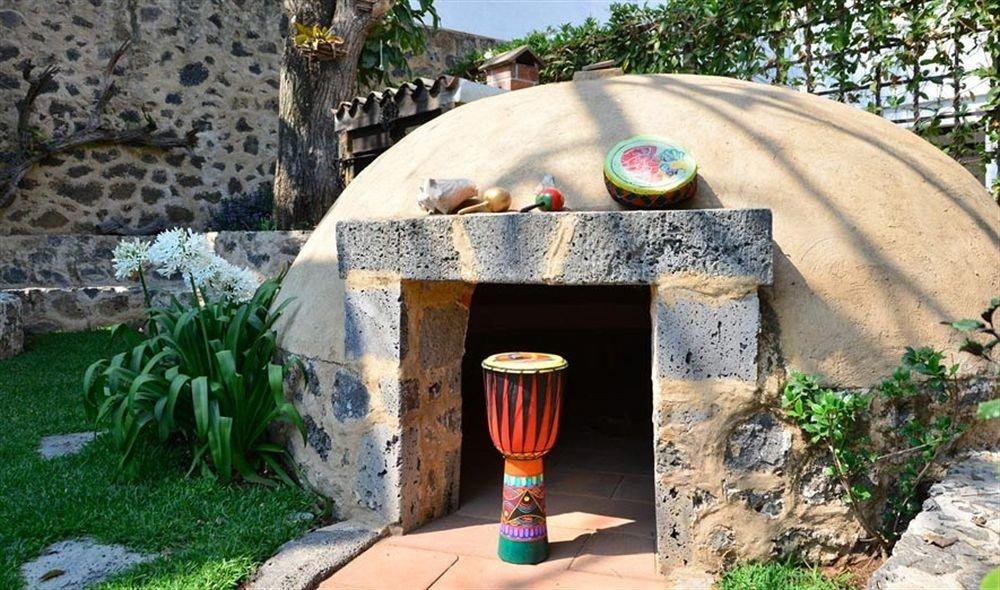 rock man made object backyard stone yard Garden masonry oven outdoor structure cottage