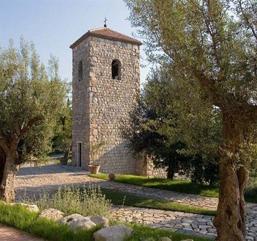 tree grass building stone brick chapel place of worship monastery old Garden surrounded tower