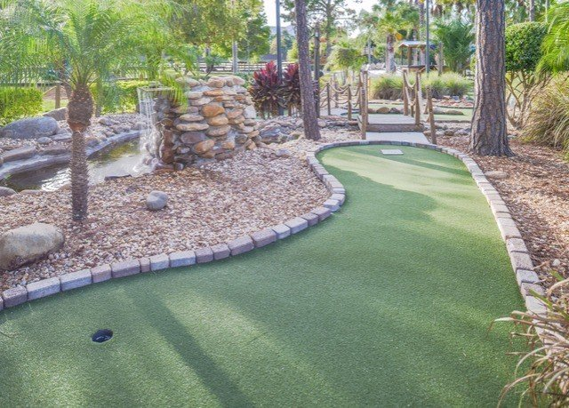 grass tree Golf lawn athletic game backyard reflecting pool miniature golf yard Garden walkway landscape architect swimming pool flooring landscaping plant