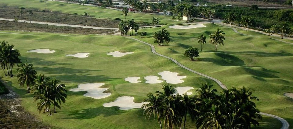 Golf Honeymoon Resort Sport Waterfront grass tree structure ball game sports sport venue pitch and putt golf course golf club plant outdoor recreation palm Nature grassland recreation park lush pond surrounded Garden