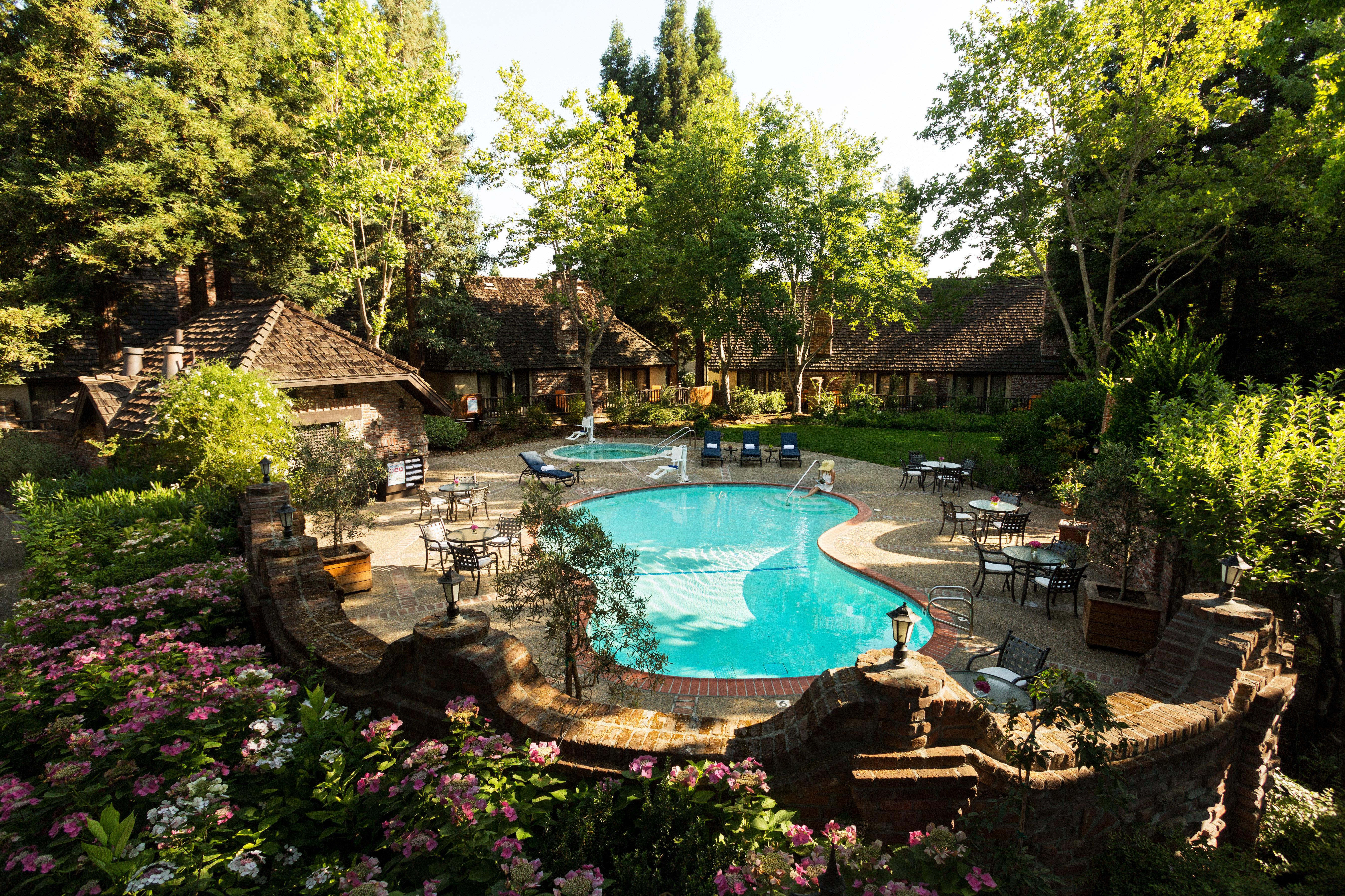 Grounds Health + Wellness Hotels Inn Patio Pool Romantic Spa Retreats Terrace Trip Ideas tree swimming pool Garden backyard Resort pond botanical garden yard mansion plant surrounded day