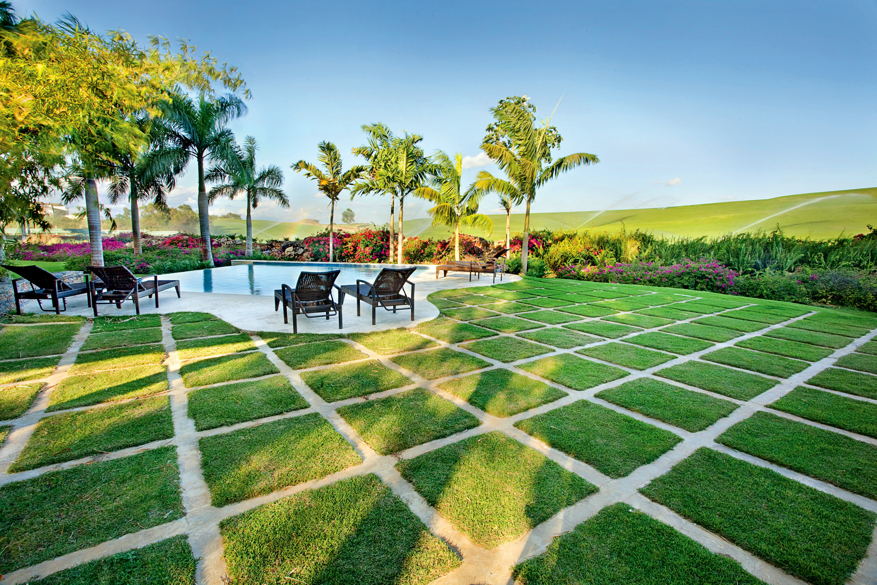 Garden Grounds Lounge Luxury Pool grass tree sky leisure structure lawn residential area sport venue Resort agriculture walkway arecales stadium park