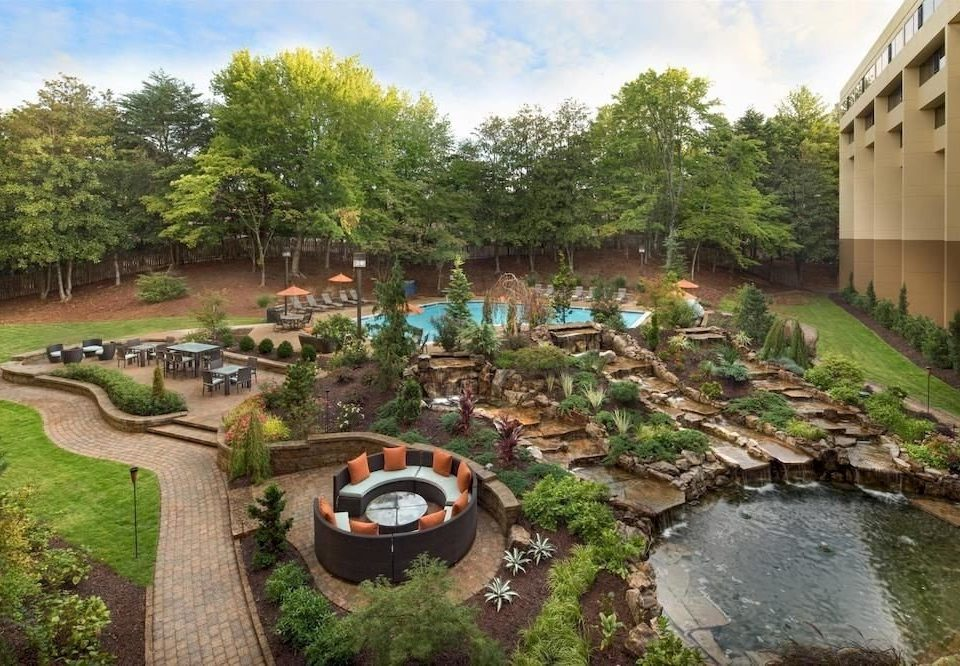 Grounds Lounge Luxury Pool tree grass sky pond Garden waterway backyard fish pond Resort yard dirt