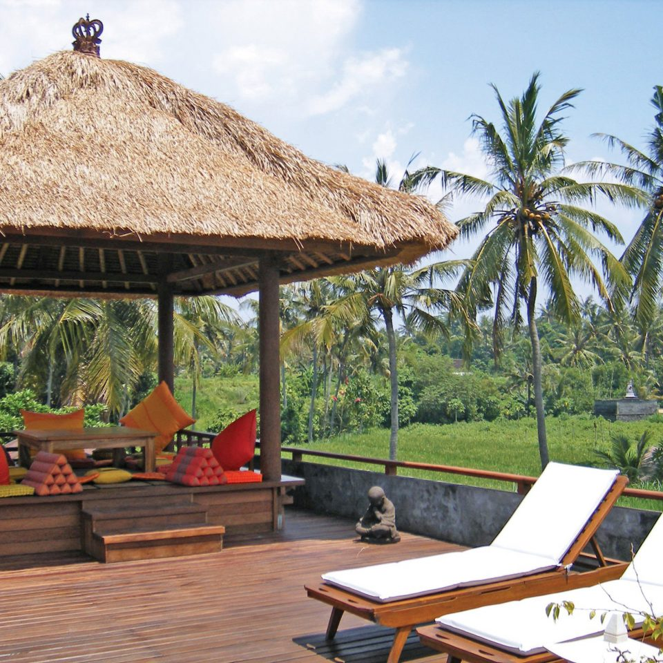 Garden Grounds Lounge tree sky leisure property Resort building gazebo Villa cottage hut outdoor structure