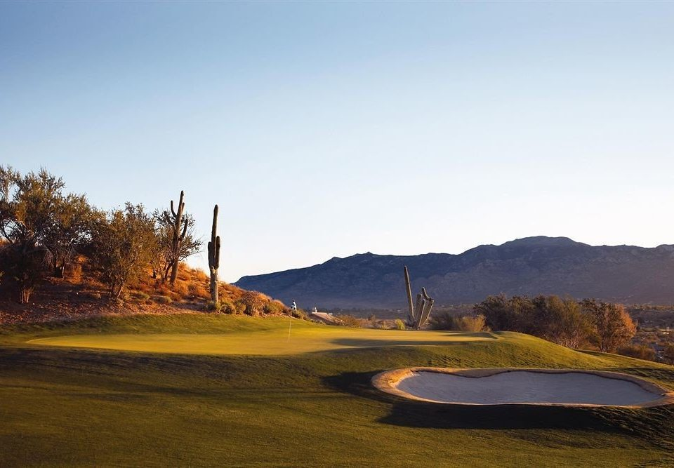 Garden Grounds Mountains Outdoors sky mountain structure Nature tree sport venue hill morning landscape golf course dusk golf club plant distance highland