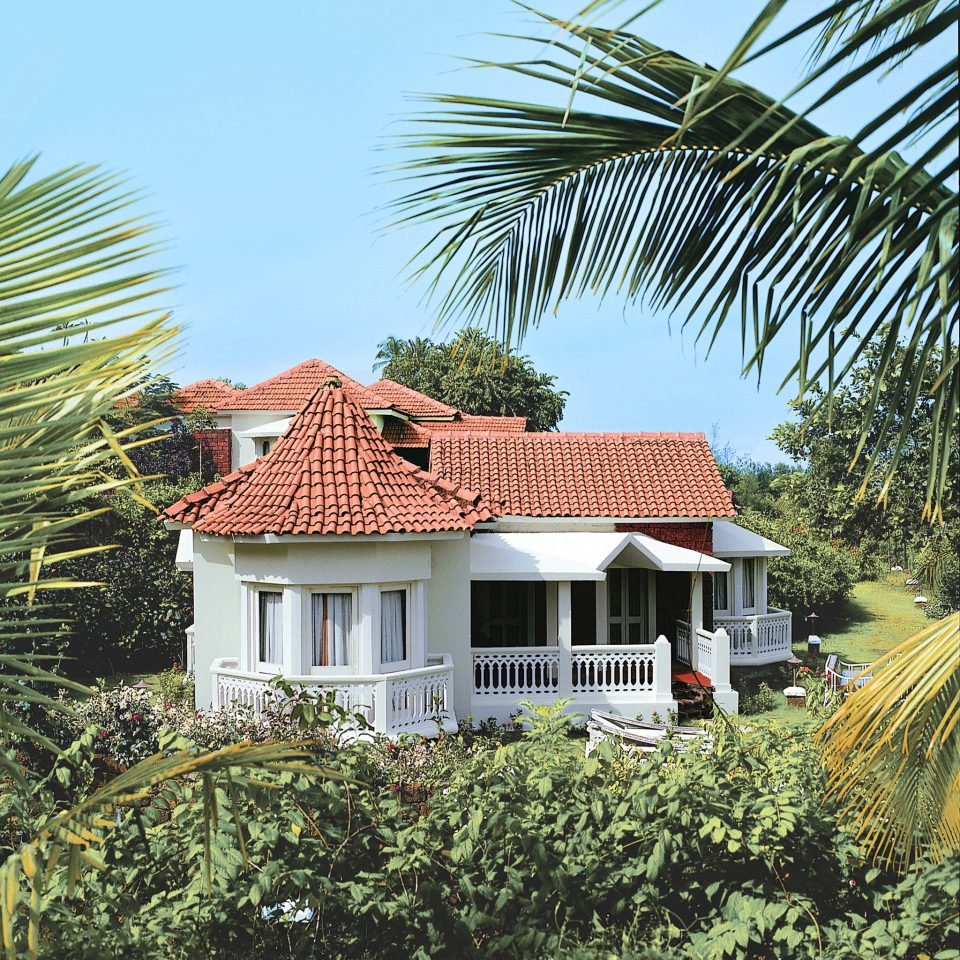 Grounds tree house property home building palm residential area arecales Resort cottage Villa roof Village mansion Garden plant bushes